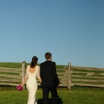 Bride and Groom in Rural Setting with Split Rail Fence