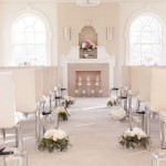 Cream and White Ceremony Pew Arrangements