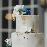 Modern Wedding Cake with Blue Floral Topper